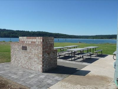 Community bbq grill and picnic tables.