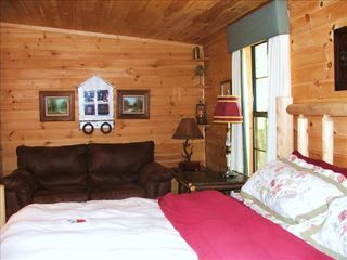 Pigeon Forge cabin photo - Bedroom with Bose stereo and a sitting area