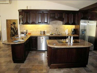 Gourmet kitchen w/ stainless steel Electrolux Appliances, center island w/ stove