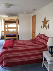 Yarmouth house photo - large upstairs bedroom with double bed and bunk