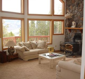 2 story great room with a couple windows to enjoy the expansive views
