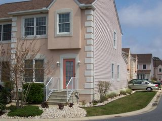 North Ocean City townhome photo - Front of building, showing the side of the unit and the sun room in the back.