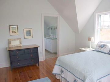 The east bedroom has a full bed, full bath, views of Sconset and lots of light.