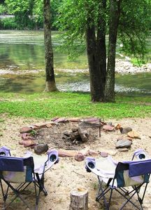 Riverfront firepit and adjustable campfire grill.