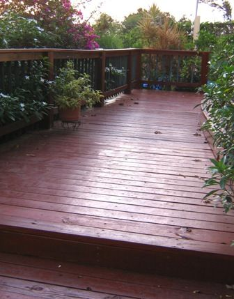 Partial view of deck in front of house.