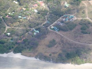 Nosara house photo - Aerial view of Guiones Beach Club - home is last house atop of a small knoll