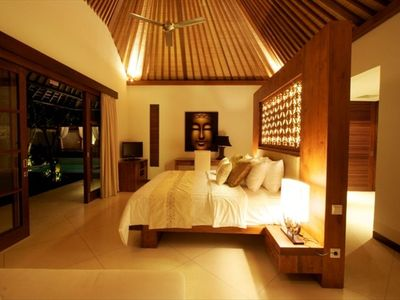 Master Bedroom with teak wood balinese furniture and romantic accent lighting