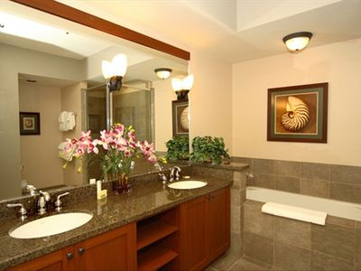 Master bathroom has two sinks,a tub, and a walk-in shower. Hairdryer included.