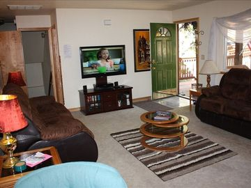 living room with 46 inch TV, BluRay player, XBOX360, and 150+ movies, netflix