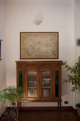 Bologna apartment photo - An early 1800's vetrina and a 1700's map - all selected with love and zest.