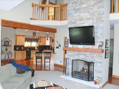"Family room with floor-to-ceiling fireplace and 52"" TV"