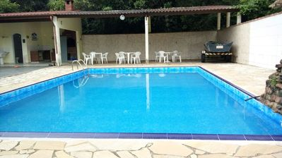 Beach house with swimming pool. in Peruíbe / -Guaraú, up to 25 pes. promotion carn. pac. 3,000