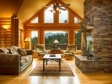 Woodland Park house rental - Gorgeous living room, fireplace, Pikes Peak view, wonderful log cabin decor!