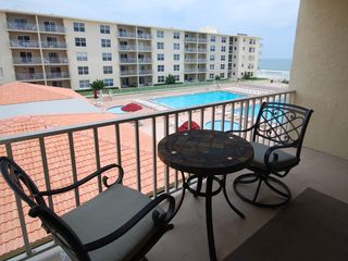 New Smyrna Beach condo photo - Dine on the balcony with a view of the pool and the ocean