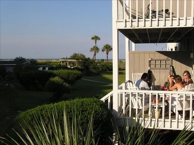 Enjoying the back deck which leads directly to pool and beach boardwalk.