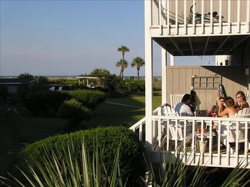 Harbor Island condo rental - Enjoying the back deck which leads directly to pool and beach boardwalk.