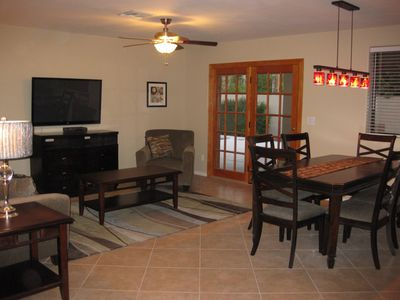 Dining area and Family Room with 50 in. TV, HD cable w/movie and music channels