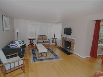 Spacious living room with flat screen TV and DVD player
