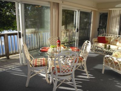 off kitchen 3 season sunroom with easy deck access