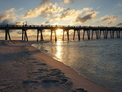 The morning sun rising over the Pensacola Beach fishing pier