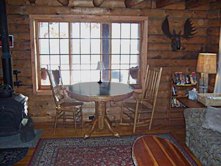 Lake Hortonia cabin photo - Window Table with GREAT view, woodburning stove with opening front to watch fire