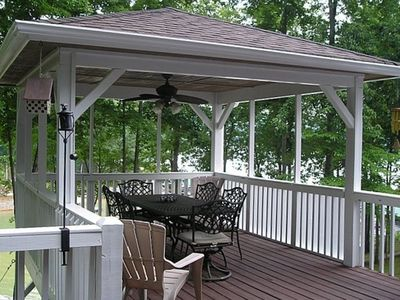 Covered porch on upper deck overlooking the lake