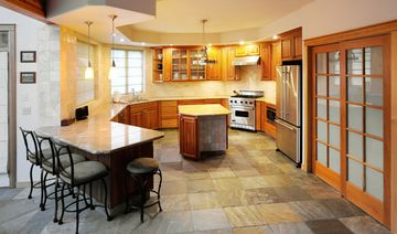 Gourmet kitchen with granite counter top, Bosch dishwasher, Viking Range