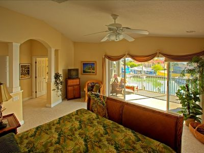 Master Bedroom suite with king bed & private patio overlooking marina.