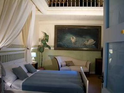 C. Adolfo room, the largest one,1 double bed and 2 single on the mezzanine