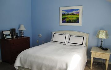 Second bedroom with queen bed and ensuite bath in relaxing blues..