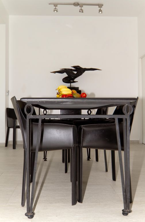 Lleather chairs and custom-made black marble and iron table.