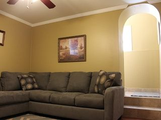 St. Louis apartment photo - Living room with new couch and arched doorway leading to front hallway/exit.