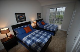 Tampa townhome photo - Bedroom # 2 w.2 full size beds, LCD-TV, balcony w. partly view of waterways