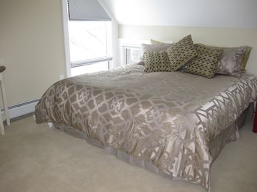 Another king-sized bed in Bedroom Three. Which one will you choose?