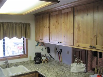 Granite counters with hockory cabinets.