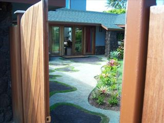 Kailua house photo - Rock wall & ironwood gate at entry of property