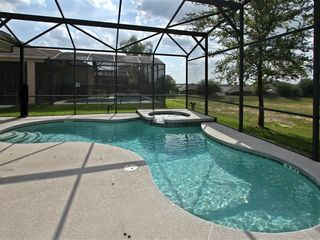 Haines City villa photo - Private swimming pool with screen encloser and children's safty fence