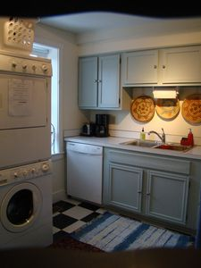 Kitchen with washing machine,dryer and dishwasher