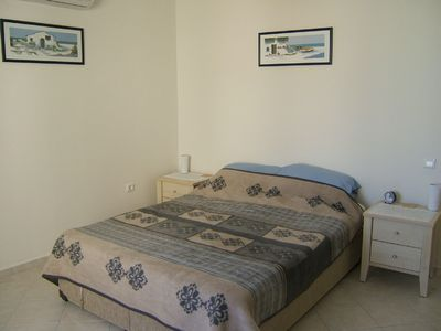 Gumusluk villa rental - The spacious master bedroom with view of pool
