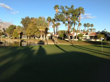 Palm Springs condo rental - View to our condo from the 7th green with the pond and mountains.