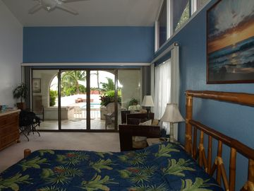 Master bedroom opens onto lanai & pool area.