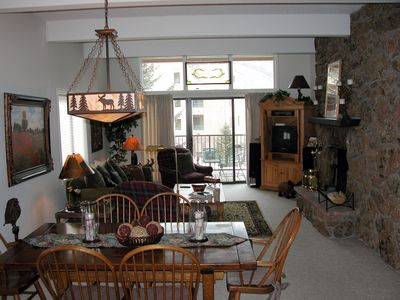 #9 living room with wood fireplace, dining table, and  balcony with gas BBQ
