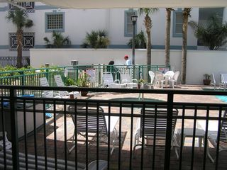 St Pete Beach condo photo - Grills for guests next to the pool