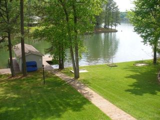 Lake Gaston house photo - Beautiful yard facing the water. 2 boat slips at the dock. Horseshoes.