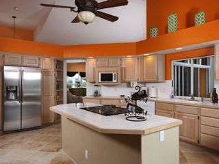 Vacation Homes in Marco Island house photo - Open kitchen with new stainless steel fridge, new stove in a cook top island
