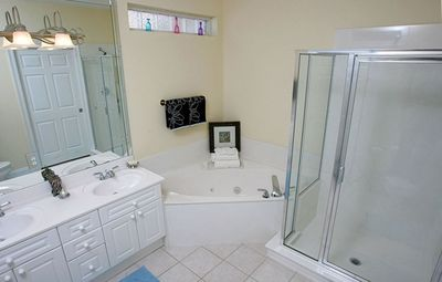 Master bathroom has a garden tub, separate shower & double vanity sinks