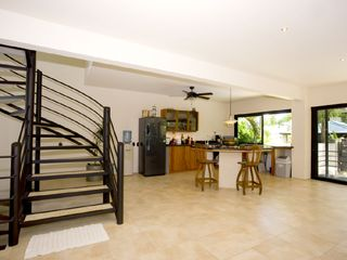 Manuel Antonio villa photo - Kitchen and stairs to master bedroom (Tipoha)