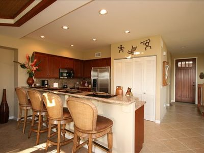 Fully-equipped gourmet kitchen with GE Monogram stainless steel appliances
