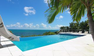 Providenciales - Provo villa photo - The water slide and dive board make for a great family fun vacation home