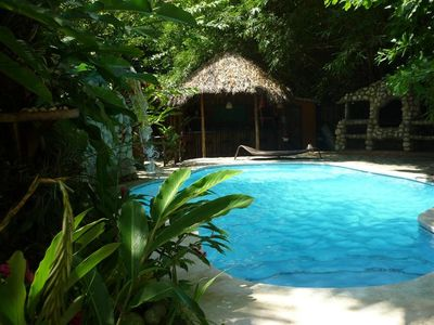 Picturesque jungle lodge with pool within walking distance to the beach.